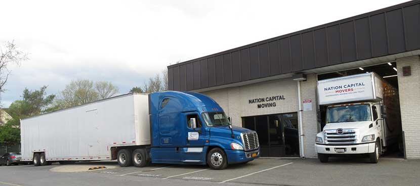 These are two of our moving trucks in front of our storage facility.
