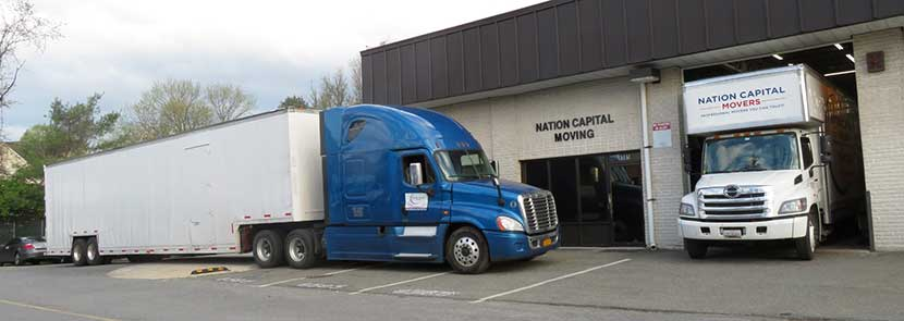 These are two of our moving trucks which are parked in front of our storage facility.