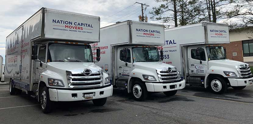 Three of our moving trucks are parked and ready for the next relocation.