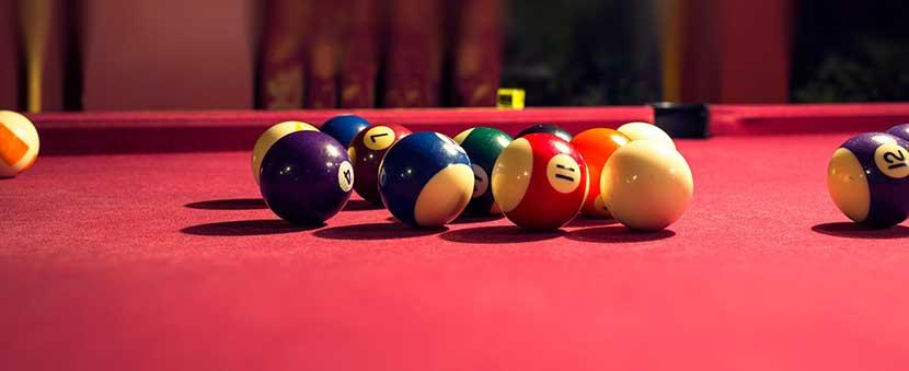 Pool table with billiard balls